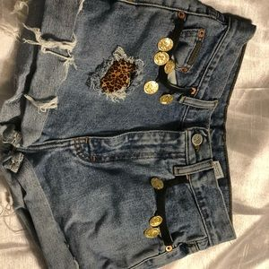 Calvin Klein distressed jean shorts